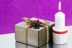 Gift box and candle Stock Photography