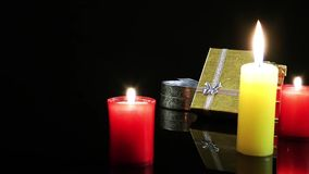 Gift Box  and Candles. Very romantic and emotional capture. Use it in any kind of project like valentines Day, birthday, new year celebration, any romantic stock video