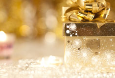 Gift box and candles Royalty Free Stock Photo
