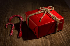 Gift box and candycane Stock Images