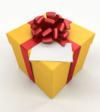 Gift box with a card. Royalty Free Stock Image