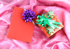 Gift box and card. On pink satin Stock Images