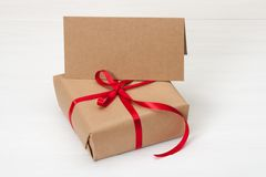 Gift Box And Card On White Wooden Background Royalty Free Stock Photography