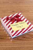Gift box with card write happy father day. On wood background Stock Images