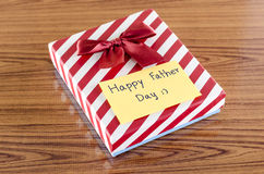 Gift box with card write happy father day. On wood background Royalty Free Stock Images