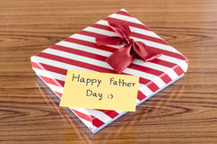 Gift box with card write happy father day. On wood background Stock Photos
