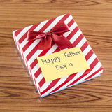 Gift box with card write happy father day. On wood background Royalty Free Stock Image