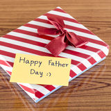 Gift box with card write happy father day. On wood background Royalty Free Stock Photos