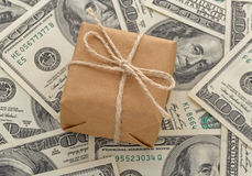 Gift box on cash. Gift box on one hundred dollars banknotes Royalty Free Stock Photos