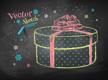 Gift box on chalkboard background. Royalty Free Stock Photos