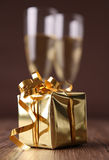 Gift box and champagne Stock Images