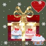 Gift box with cherry cake. Bow and snowflakesz Stock Photos