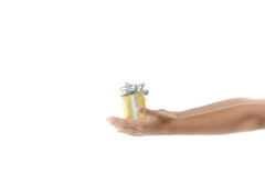 Gift box in child hand. Stock Photos