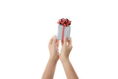 Gift box in child hand. Royalty Free Stock Image