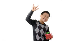 Gift box in child hand. Royalty Free Stock Images