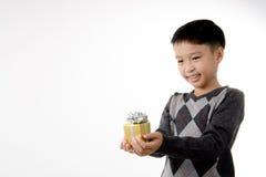 Gift box in child hand. Stock Photo