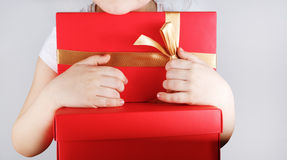 Gift box in children hands Royalty Free Stock Image