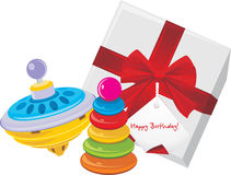 Gift box with children pyramid and whirligig toy Royalty Free Stock Images