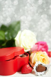Gift box, chocolate and flowers Royalty Free Stock Photo