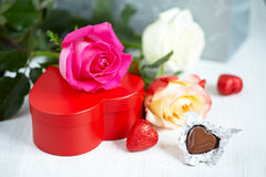 Gift box, chocolate and flowers Stock Photos