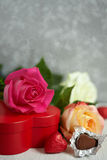 Gift box, chocolate and flowers Royalty Free Stock Photography
