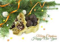 Gift box with chocolates and conifer branches Royalty Free Stock Photo