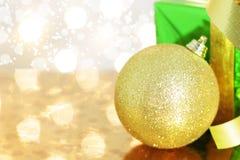 Gift box and Christmas ball Stock Images