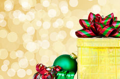 Gift box and Christmas ball - holiday's concept Royalty Free Stock Photos