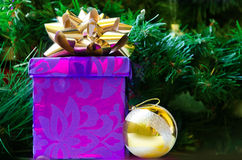 Gift box and Christmas ball - holiday's concept Stock Photography