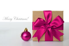 Gift box, Christmas ball and Marry Christmas text Royalty Free Stock Photos