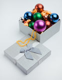 Gift box with christmas balls Royalty Free Stock Photos