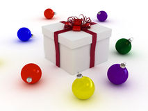 Gift box and christmas balls Royalty Free Stock Images