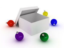 Gift box and christmas balls Royalty Free Stock Photos
