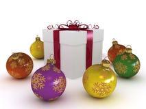 Gift box and christmas balls Stock Photos