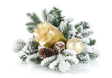 Gift box and christmas decor on snowy fir tree Royalty Free Stock Image