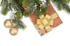 Gift box and christmas decor under snowy fir tree Royalty Free Stock Photography