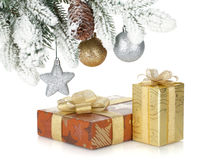 Gift box and christmas decor under snowy fir tree Stock Images
