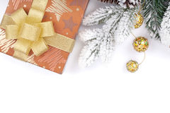 Gift box and christmas decor under snowy fir tree Stock Image