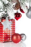 Gift box and christmas decor under snowy fir tree Royalty Free Stock Images