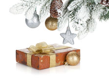 Gift box and christmas decor under snowy fir tree Stock Photography