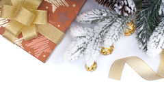 Gift box and christmas decor under snowy fir tree Royalty Free Stock Photo
