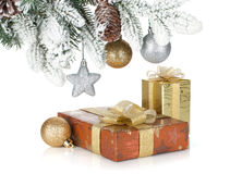 Gift box and christmas decor under snowy fir tree Stock Photo