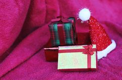 Gift box and christmas decoration with macro close up on red car stock photography
