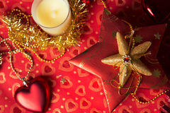 Gift in box with christmas decoration at red background Royalty Free Stock Photos