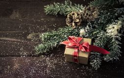 Gift box with Christmas decoration . Gift box with Christmas decoration on wooden background Royalty Free Stock Photo