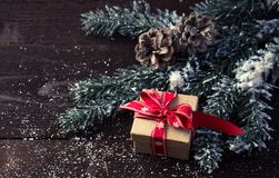 Gift box with Christmas decoration . Gift box with Christmas decoration on wooden background Royalty Free Stock Images