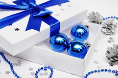 Gift box with christmas decorations Royalty Free Stock Photos