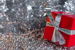 Gift Box among Christmas decorations Stock Image