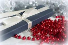 Gift Box among Christmas decorations Stock Photo
