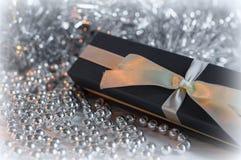 Gift Box among Christmas decorations Stock Photography